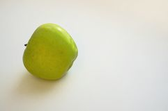 Green apple. One green apple on a white background royalty free stock photo