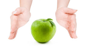 Green apple between open hands Royalty Free Stock Photography