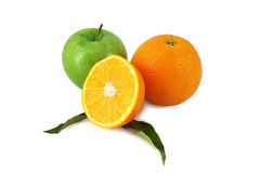 Green apple, orange and a half Royalty Free Stock Photography