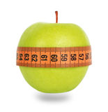 Green apple and orange measuring tape Stock Image