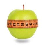 Green apple and orange measuring tape Stock Image
