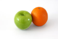 Green apple and orange. On white background Stock Photo