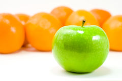 A Green Apple and Oranges Royalty Free Stock Image