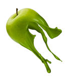 Green apple with paint splash Stock Photography