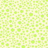 Green apple on the pale yellow background. Seamless pattern Stock Images