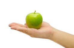 Green apple on the palm in isolated background Royalty Free Stock Photo