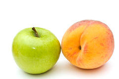 Green apple and peach. Royalty Free Stock Photography