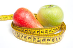 Green Apple and Pear with measuring tape Stock Photography