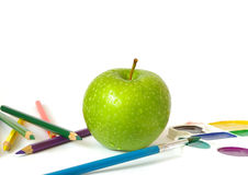 Green apple and pencils royalty free stock image