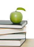 Green apple on pile of books Royalty Free Stock Photo