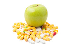 Green apple on pills Royalty Free Stock Photos