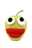 Green apple with plasticine smile Stock Image