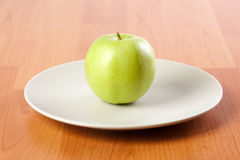 Green apple on plate Stock Image