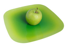 Green apple on a plate Stock Image