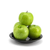 Green apple with plate Royalty Free Stock Images