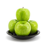 Green apple with plate Stock Photography
