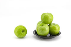 Green apple with plate Stock Images