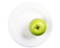 Green apple on a plate Stock Photo
