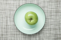 Green apple on plate Royalty Free Stock Photo