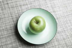 Green apple on plate Stock Photo