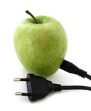Green apple with a plug Stock Photography