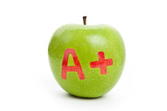 Green apple and A Plus sign Royalty Free Stock Photos