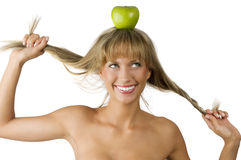 Green apple and pulling hair Stock Photo