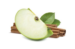 Green apple quarter piece cinnamon in the back isolated Royalty Free Stock Photos