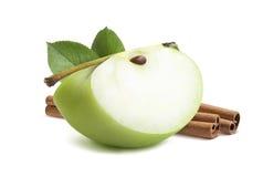 Green apple quarter piece cinnamon isolated on white Stock Photos
