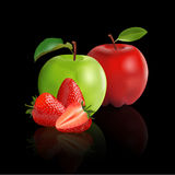 Green apple, red apple and strawberry. Isolated on black background Royalty Free Stock Photos