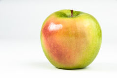 Green apple with red cheek Royalty Free Stock Photo