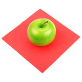 Green apple on a red napkin Stock Photo