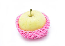 Green apple with red package. Royalty Free Stock Photos