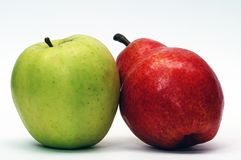 Green apple and red pear Royalty Free Stock Photography