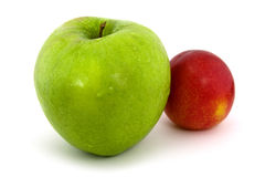 Green apple and red plum Stock Image