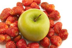Green apple and red strawberry Stock Photos