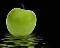 Green apple reflection Stock Image