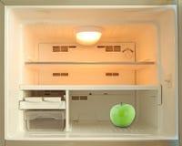 Green apple in refrigerator Stock Image