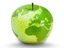 Green apple representing earth with drops on it. On white background Royalty Free Stock Images