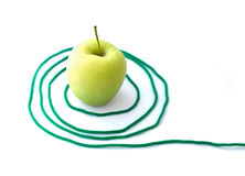 Green apple with a rope Stock Photo