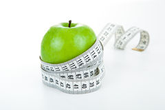 Green apple with a ruler Royalty Free Stock Image