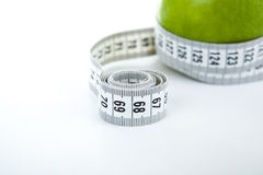 Green apple with a ruler Stock Photo