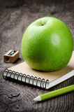 Green apple and school supplies Stock Image