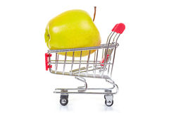 Green apple in shopping cart Stock Photo