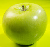 Green apple. Sitting on green table stock images