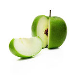 Green apple and slice. Isolated over a white background Royalty Free Stock Photography