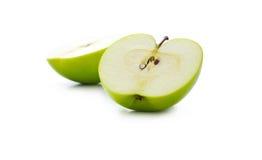 Green apple slice on white background, defocused Stock Photos
