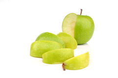 Green apple sliced. Isolated white background Stock Images