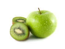Green apple and sliced kiwi on white. Green apple and sliced kiwi (white background). Fresh diet fruit (water drops). Healthy fruit with vitamins Royalty Free Stock Photos