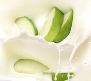Green apple slices and milk Stock Photo